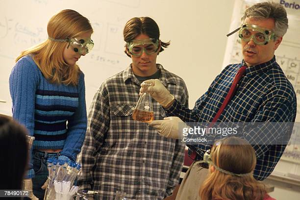 Professor and students in lab class