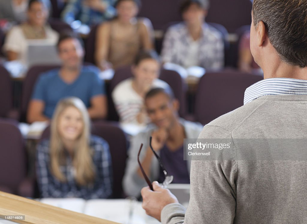 Professor and students in lecture hall : Stock Photo