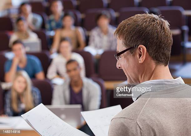Professor and university students in lecture hall