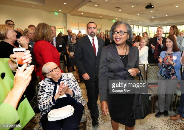 Professor Anita Hill gets a standing ovation as she arrives for a speech to students, faculty and guests on the campus of the University of Utah on...