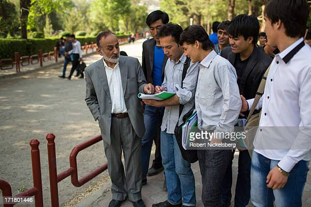 Professor answers questions from students May 14, 2013 on the campus of Kabul University in Kabul, Afghanistan. Kabul University is attended by more...