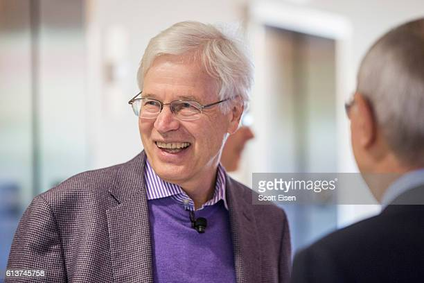Professor Bengt Holmstrom talks with MIT President L. Rafael Reif before a press conference at MIT announcing his shared Nobel Prize in Economics...