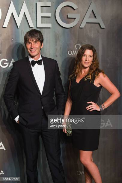 Professor Brian Cox and Gia Milinovich attends the Lost In Space event to celebrate the 60th anniversary of the OMEGA Speedmaster which has been worn...