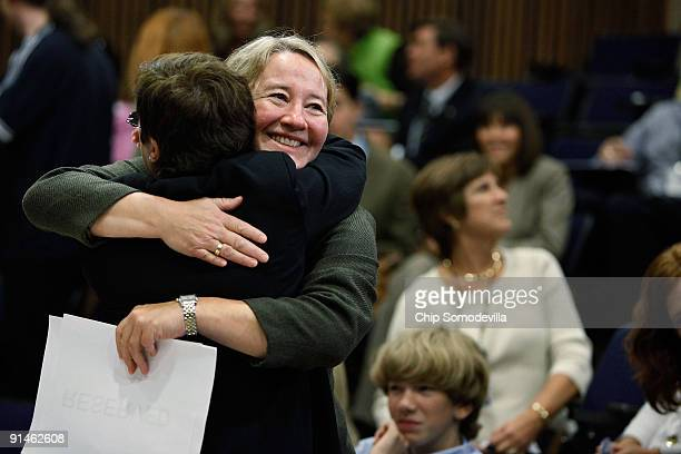 Professor Carol Greider gets a hug before a news conference where she talked about winning the 2009 Nobel Prize in Physiology or Medicine at Johns...
