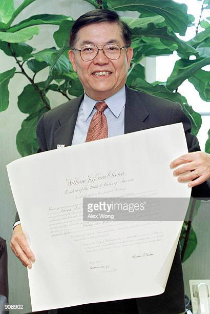 Professor Chang-Lin Tien holds his appointment certificate which signed by President Clinton after he was sworn in as a National Science Board member...
