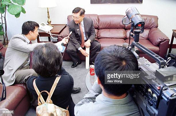 Professor Chang-Lin Tien is interviewed by media after he was sworn in as a National Science Board member at the National Science Foundation building...