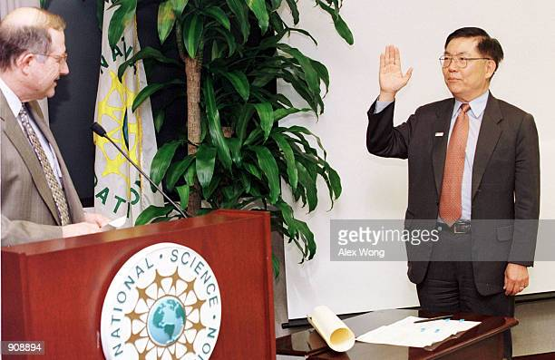 Professor Chang-Lin Tien is sworn in as a National Science Board member by Neal Lane, White House Science and Technology Advisor, at the National...