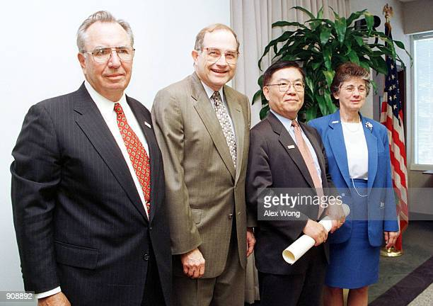 Professor Chang-Lin Tien, third from left, poses for photographers with, from left, Eamon Kelly, Chairman of National Science Board, Neal Lane, White...