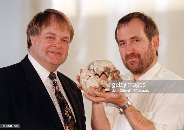 Professor Chris Stringer from the Natural History Museum holds the 9 thousand yearold skull of Cheddar Man with Dr Bryan Sykes of Oxford University...
