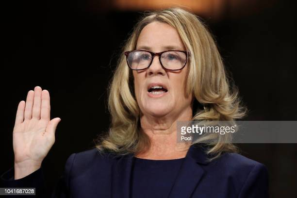 Professor Christine Blasey Ford who accused US Supreme Court nominee Brett Kavanaugh of a sexual assault in 1982 is sworn in to testify before a...