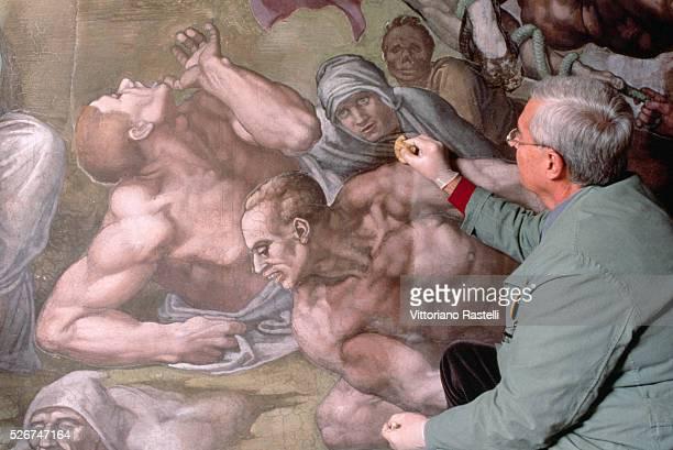 Professor Colalucci restores a fresco painting in the Sistine Chapel