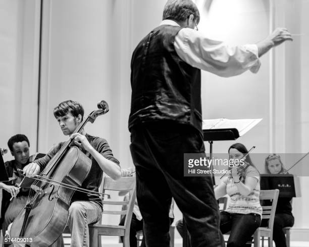 Professor conducting college orchestra