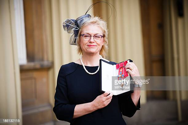 Professor Dame Nicola Cullum poses with her Dame Commander of the Order of the British Empire insignia after she became the first person to receive...