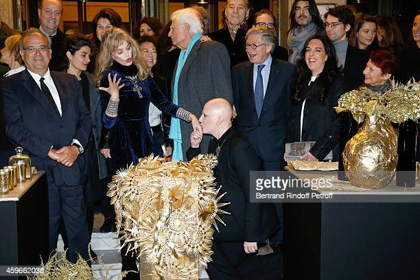 Professor David Khayat actress Arielle Dombasle Artist Ali Mahdavi President of 'Comite Montaigne' JeanClaude Cathalan Guest and Barbara Rihl attend...