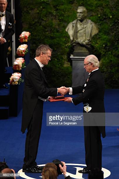 Professor Edvard I Moser laureate of the Nobel Prize in Physiology or Medicine receives his Nobel Prize from King Carl XVI Gustaf of Sweden during...