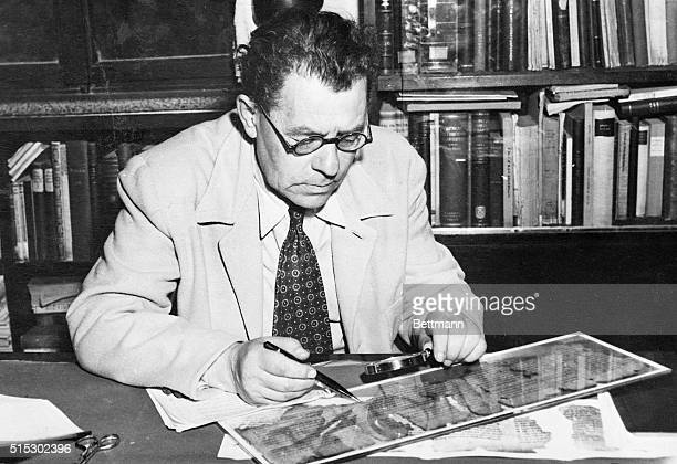 Professor Eleazer L Sukenik Dir of the Hebrew University' Museum of Jewish Antiquities studies a fragment of one of the ancient Hebrew Scrolls which...
