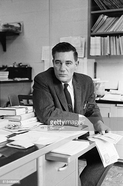 Professor Elso S Barghoorn of Harvard University studies news clippings telling of the arrest of his brother Yale Professor Frederick Barghoorn by...