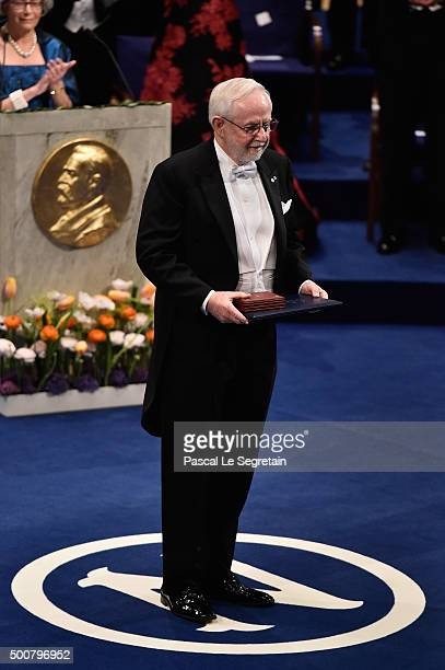 Professor Emeritus Arthur B McDonald laureate of the Nobel Prize in Physics acknowledges applause after he received his Nobel Prize from King Carl...