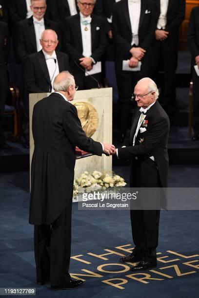 Professor Emeritus James Peebles laureate of the Nobel Prize in Physics receives his Nobel Prize from King Carl XVI Gustaf of Sweden during the Nobel...
