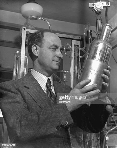 Professor Enrico Fermi, famed Italian physicist who won the 1938 Nobel Prize for his discovery of radioactive substances, is pictured inspecting...