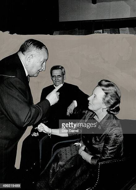 Professor Etienne Gilson makes a point with GovernorGeneral's wife Mrs Roland Michener during a chat Paul Cardinal Leger of Montreal sits in centre...