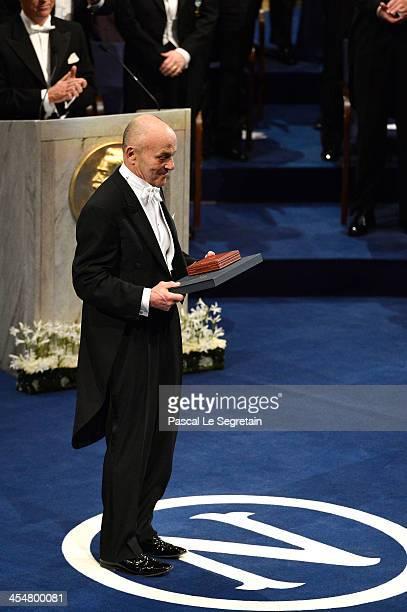 Professor Eugene F. Fama, laureate of The Sveriges Riksbank Prize in Economic Sciences in Memory of Alfred Nobel acknowledges applause after he...