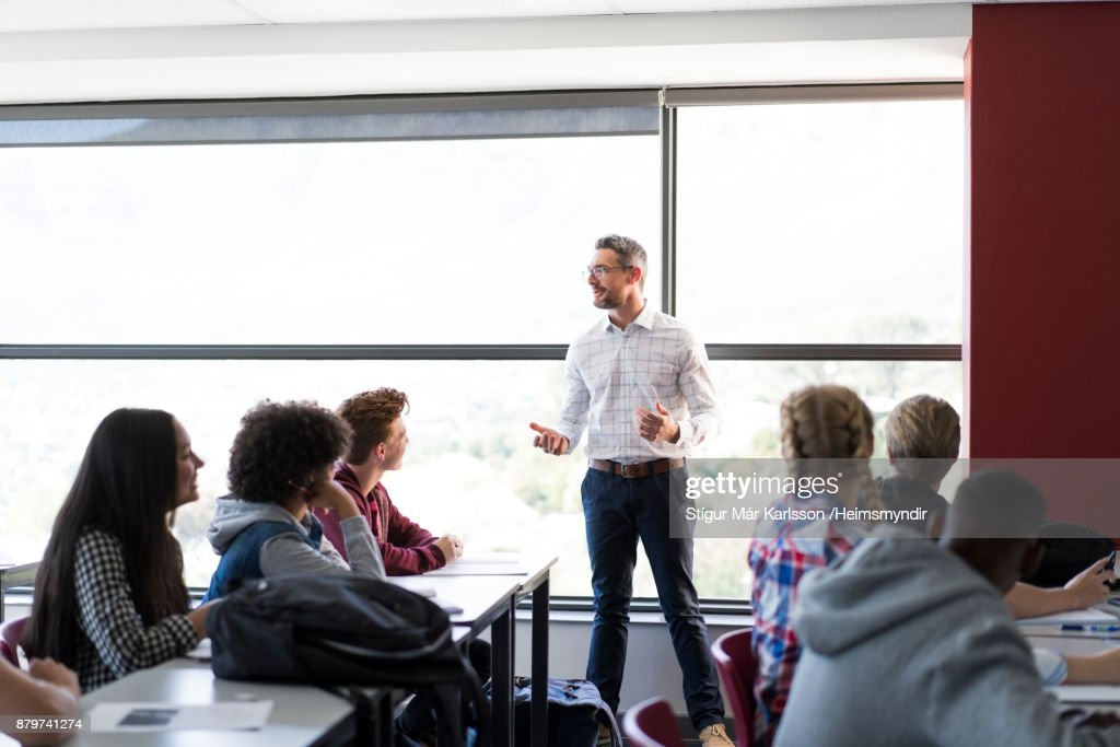 Professor explaining to multi-ethnic students : Stock Photo