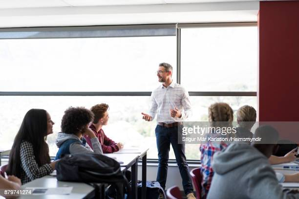 Professor explaining to multi-ethnic students