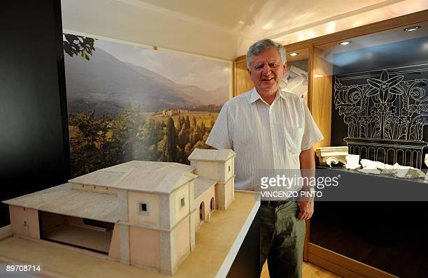Professor Filippo Coarelli poses beside a scalemodel of the house of Roman Emperor Vespasian in the village of Cittareale some 70 kms from Rome The...