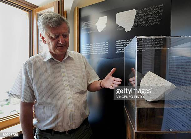 Professor Filippo Coarelli poses beside a stone found in the house of Roman Emperor Vespasian in the village of Cittareale some 70 kms from Rome The...