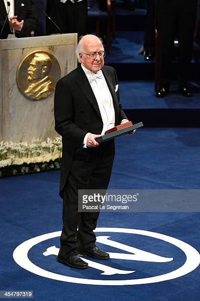 Professor Francois Englert laureate of the Nobel Prize in Physics acknowledges applause after he received his Nobel Prize from King Carl XVI Gustaf...