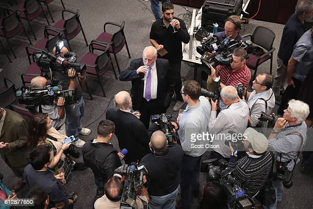 Professor Fraser Stoddart of Northwestern University sips champagne as he chats with students, colleagues, and media after it was announced that he...