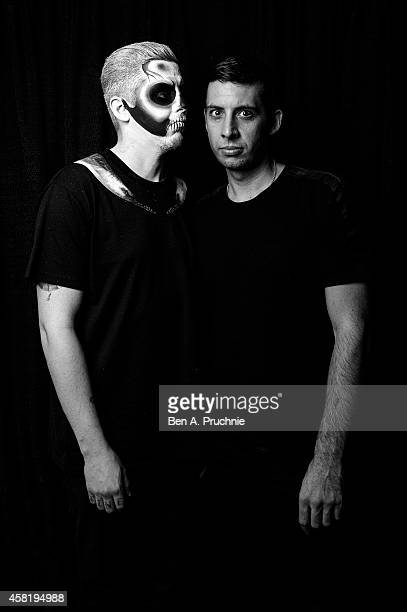 Professor Green and Example poses backstage at the KISS FM Haunted House Party at Eventim Apollo Hammersmith on October 31 2014 in London England