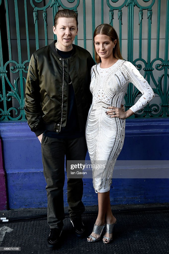 Professor Green and Millie Mackintosh attend the Julien Macdonald show during London Fashion Week SS16 on September 19, 2015 in London, England.