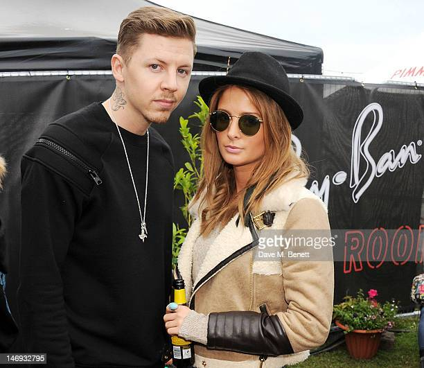 Professor Green and Millie Mackintosh attend the RayBan Rooms during day two of the Isle of Wight Festival at Seaclose Park on June 23 2012 in...