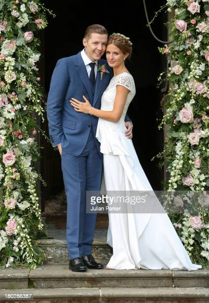 Professor Green and Millie Mackintosh pose on their wedding day at Babington House on September 10 2013 in Frome England
