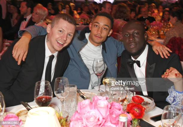 Professor Green Loyle Carner and Stormzy attend a drinks reception ahead of The Fashion Awards 2017 in partnership with Swarovski at Royal Albert...