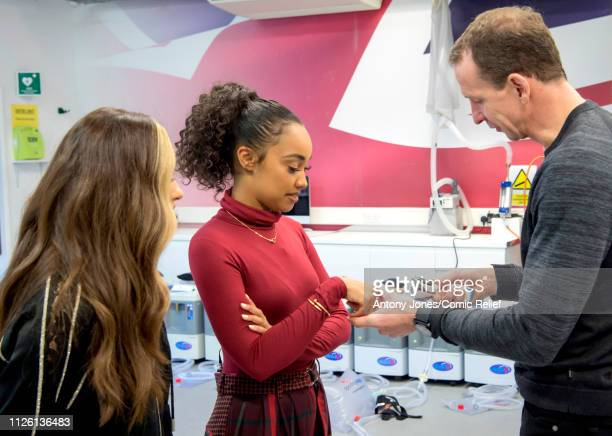 Professor Greg Whyte puts a finger pulse oximeter on LeighAnne Pinnock from Little Mix as Jade Thirlwall looks on during altitude training ahead of a...