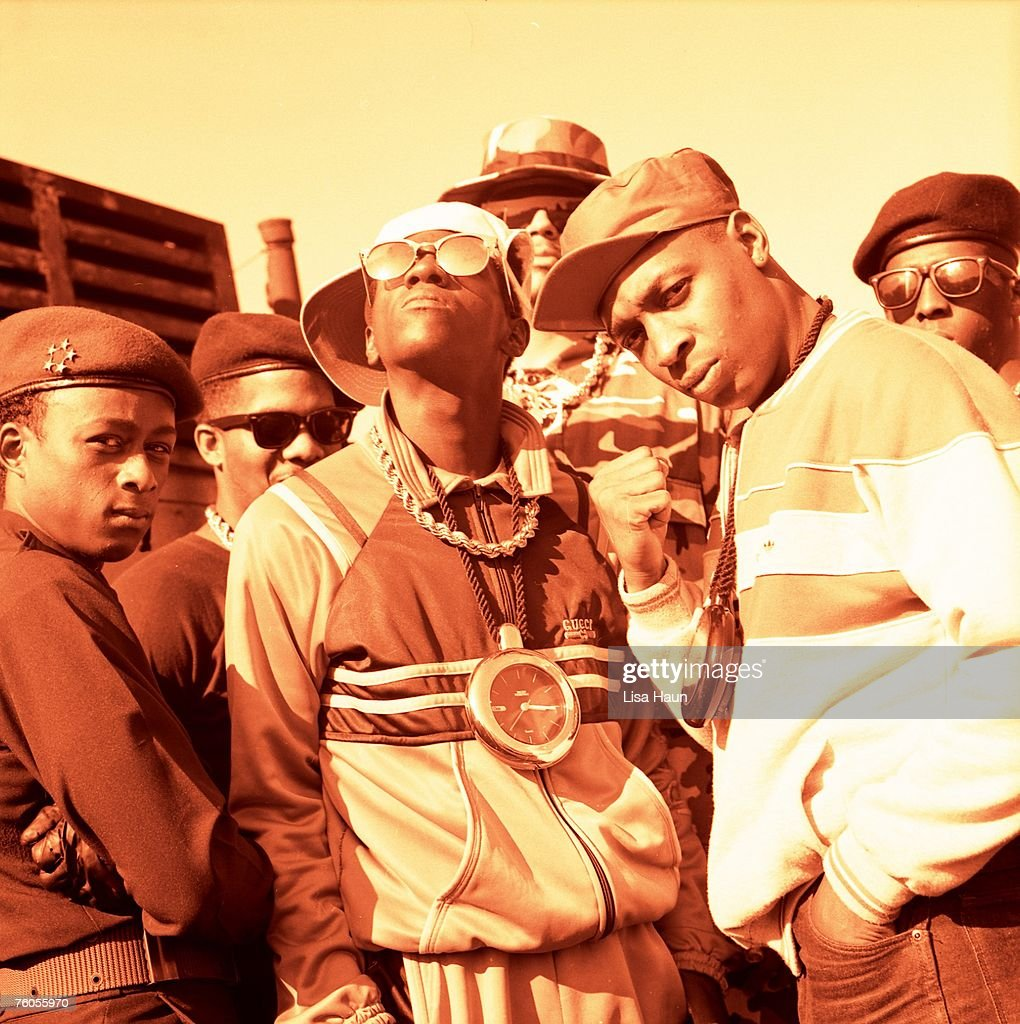 Professor Griff, S1W, Flavor Flav, Terminator X, Chuck D and another member of their S1W security unit of the rap group Public Enemy pose for a portrait in circa 1988.