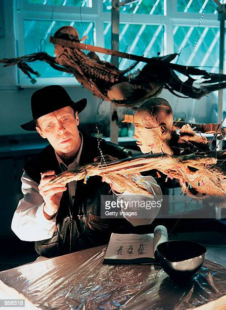 Professor Gunter Von Hagens adjusts one of his anatomical specimens March 20 2002 at The Atlantis Gallery in the Old Truman Brewery in London's Brick...