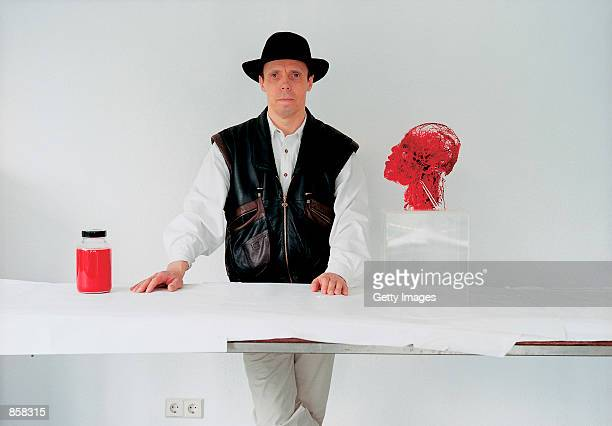 Professor Gunter Von Hagens stands next to one of his anatomical specimens March 20 2002 at The Atlantis Gallery in the Old Truman Brewery in...