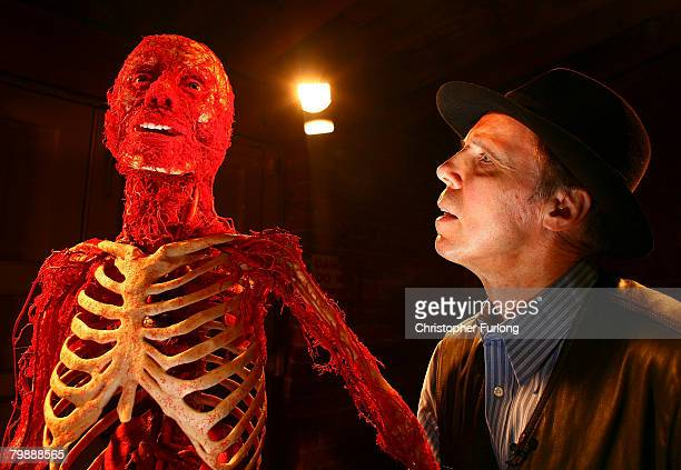 Professor Gunther Von Hagens stands next to one of his anatomical specimens showing the human arterial system at the launch of his latest exhibition...