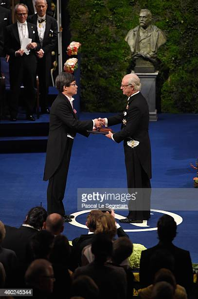 Professor Hiroshi Amano laureate of the Nobel Prize in Physics receives his Nobel Prize from King Carl XVI Gustaf of Sweden during the Nobel Prize...