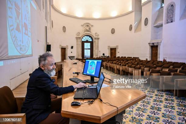 A professor holds an online lecture in the Aula Magna of the Faculty of Letters of the University of Catania without students due to the Coronavirus...