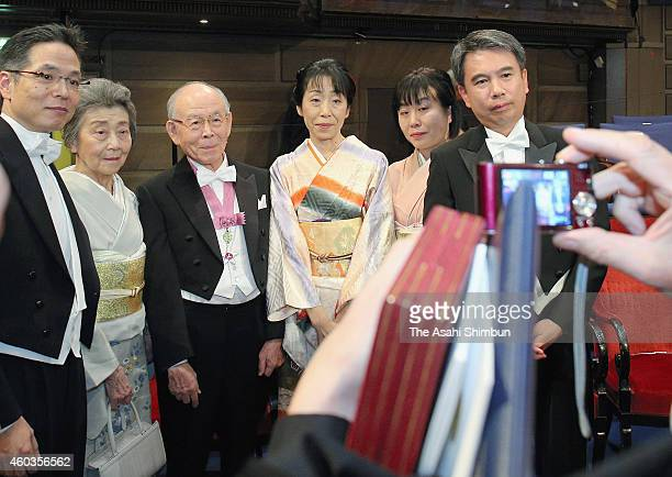 Professor Isamu Akasaki and his family members pose for photographs after the Nobel Prize Award Ceremony 2014 at Concert Hall on December 10 2014 in...