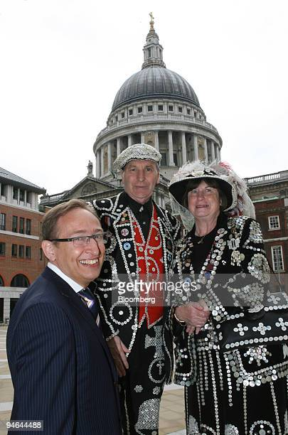 Professor Jack Lohman, director of the Museum of London, left, poses with the Pearly King and Queen of Crystal Palace, Pat and Carole Jolly outside...