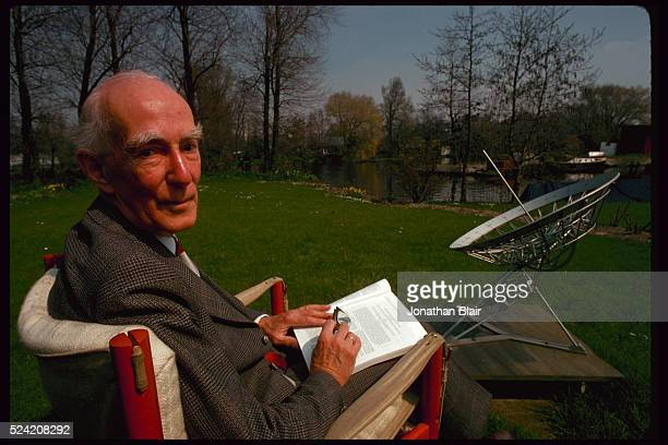 Professor Jan H Oort in his backyard He sits next to a sundial shaped like the Westerbork radio telescope a gift from the staff of the University of...