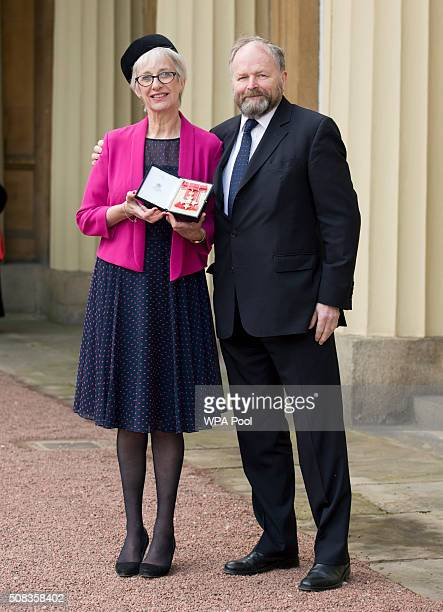 Professor Jane Anderson at Buckingham Palace London with husband Clive Anderson after she was made a CBE by the Prince of Wales on February 4 2016 in...