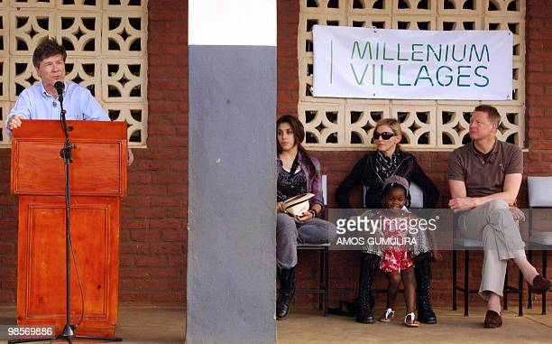 Professor Jeffrey Sachs economist and special advisor to the UN Secretary General speaks to audience as US artist Madonna her adopted daughter Mercy...