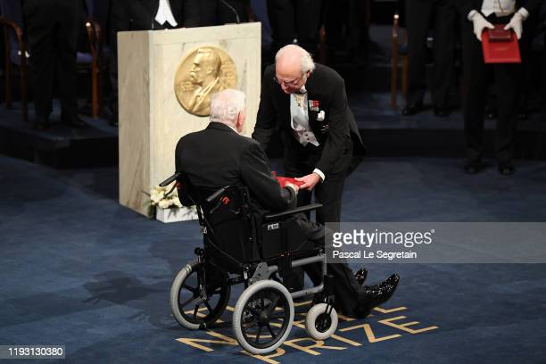 Professor John B Goodenough laureate of the Nobel Prize in Chemistry receives his Nobel Prize from King Carl XVI Gustaf of Sweden during the Nobel...